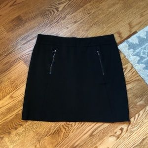 Ladies black mini A-line, knit skirt with pockets